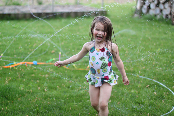 Abbi in the sprinkler